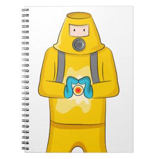 Dibujo animado del hombre de la contención del spiral notebooks