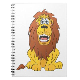 Dibujo animado del león libros de apuntes con espiral