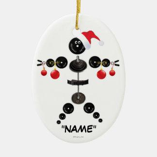 Dibujo animado del levantamiento de pesas del adorno navideño ovalado de cerámica