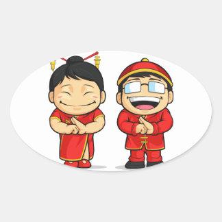 Dibujo animado del muchacho y del chica chinos pegatina ovalada