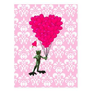 Dibujo animado divertido de la rana y corazón rosa postal