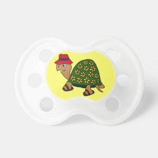 Dibujo animado divertido de la tortuga de la flor  chupetes para bebes