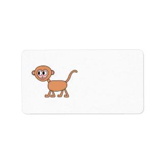 Dibujo animado divertido de un mono etiqueta de dirección