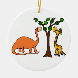Dibujo animado divertido del dinosaurio y de la adorno navideño redondo de cerámica