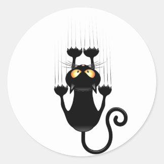 Dibujo animado divertido del gato negro que rasguñ pegatina