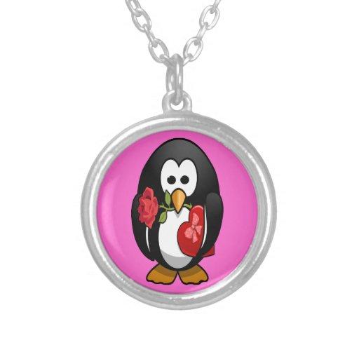 Dibujo animado divertido del pingüino lindo del el colgante redondo