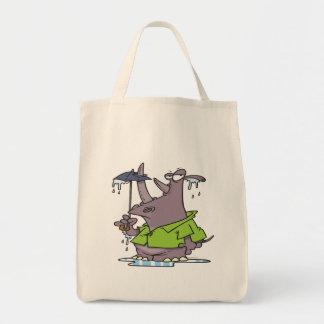 dibujo animado divertido del rinoceronte del día l bolsas