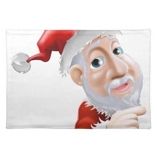 Dibujo animado feliz Santa que señala al lado Mantel Individual