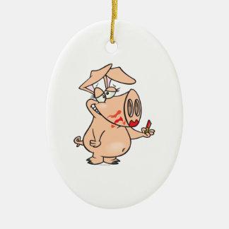 dibujo animado guarro del cerdo del lápiz labial adorno navideño ovalado de cerámica