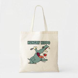 dibujo animado hambriento divertido del hipopótamo bolsa