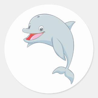 Dibujo animado juguetón lindo del delfín pegatina redonda