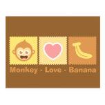 Dibujo animado lindo del mono, del amor y del plát postal
