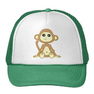 Dibujo animado lindo del mono gorro