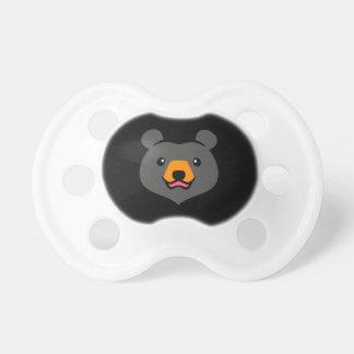 Dibujo animado lindo minimalista del oso negro chupete de bebe