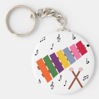 Dibujo animado multicolor del instrumento musical llavero