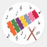 Dibujo animado multicolor del instrumento musical  etiqueta