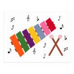 Dibujo animado multicolor del instrumento musical  postales