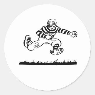 Dibujo animado retro del fútbol etiquetas redondas