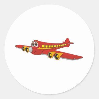 Dibujo animado rojo del avión de pasajeros O Etiquetas Redondas