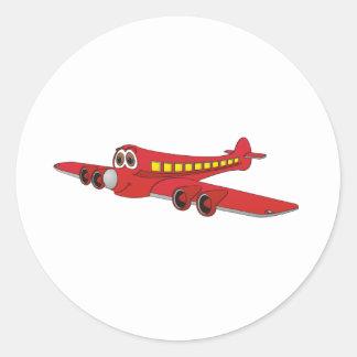 Dibujo animado rojo del avión de pasajeros pegatina redonda