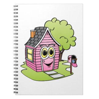 Dibujo animado rosado de la casa libretas