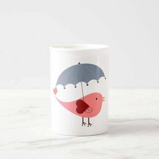 Dibujo animado rosado del pájaro taza de porcelana