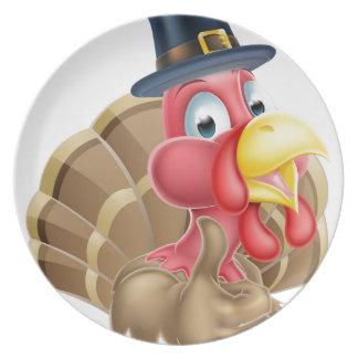Dibujo animado Turquía en gorra del peregrino Platos