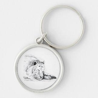 Dibujo blanco durmiente de la cabeza del tigre y d llavero redondo plateado