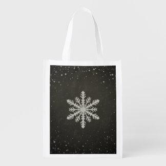Dibujo de tiza blanco del copo de nieve del bolsa para la compra