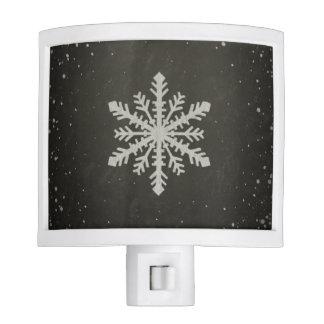 Dibujo de tiza blanco del copo de nieve del luces de noche