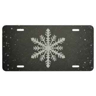 Dibujo de tiza blanco del copo de nieve del placa de matrícula