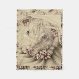 Dibujo de un Pitbull blanco en la manta