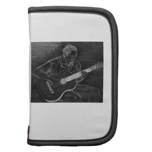 Dibujo del guitarrista, blanco en la versión negra organizadores