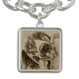 Dibujo del perro que bebe en la pulsera