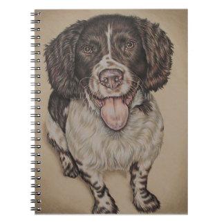 Dibujo lindo del perro de aguas feliz en el notebook