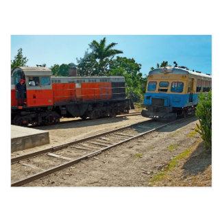 Diesellocomotive and railcar meeting postcard