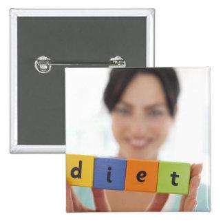Dieting, conceptual image. button