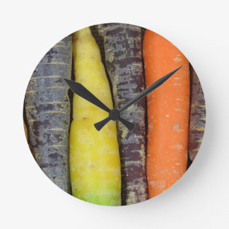 Different colored carrots round clock