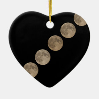 Different phases of rising full moon ceramic ornament