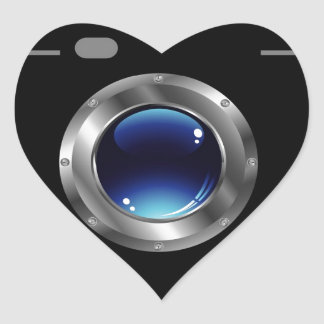 Digital camera with a glossy blue aperture heart sticker