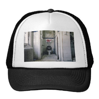 Dilapidated bathroom with graffiti trucker hat