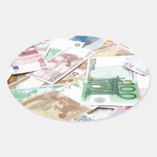 Dinero & riqueza pegatina ovalada