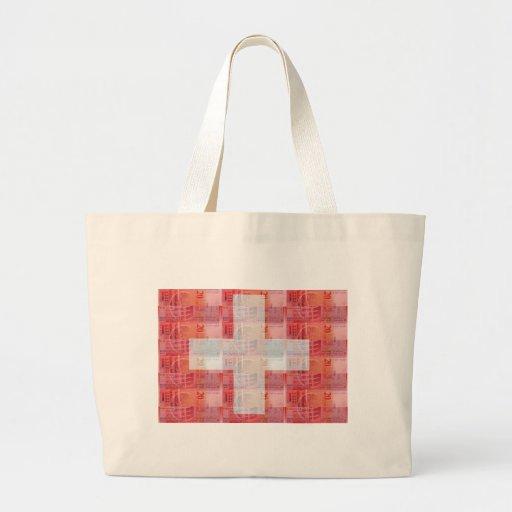 Dinero y bandera suizos bolsas