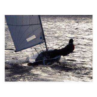 Dinghy Sailing Into The Sun Postcard
