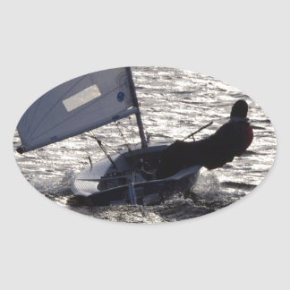 Dinghy Sailing Into The Sun Oval Stickers