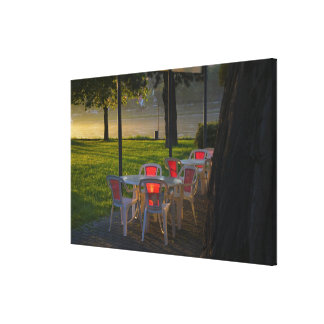 Dining table and chairs by the Danube River, Canvas Print