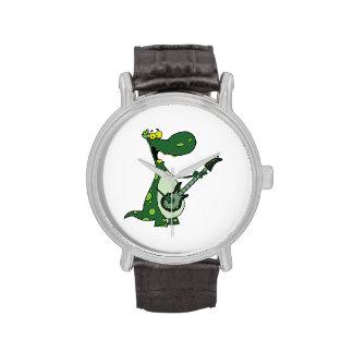 Dino verde que sostiene la guitarra gráfica relojes