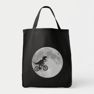 Dinosaur on a Bike In Sky With Moon Tote Bags