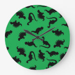 Dinosaur Silhouettes on Green Background Pattern Wall Clocks