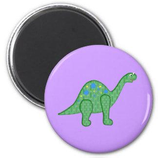 Dinosaurio amistoso imán redondo 5 cm